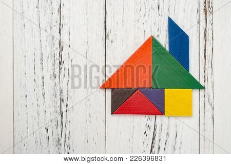 Wooden Tangram Shaped Like A House With Copy Space
