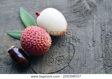 Fresh Organic Lychee Fruits On A Rustic Wooden Background.lychees.raw Diet Or Vegan Food Concept. Se