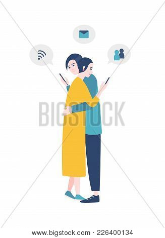 Pair Of Man And Woman Standing, Hugging And Checking Social Media Accounts On Their Smartphones. Gad