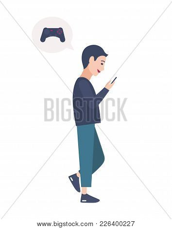 Young Boy Walking On Street And Playing Online Video Game On His Smartphone. Person Addicted To Mobi