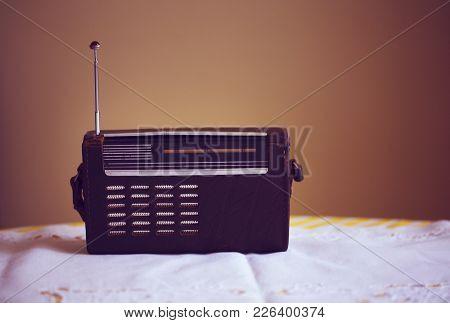 Antique Radio On Vintage Background. Toned Image
