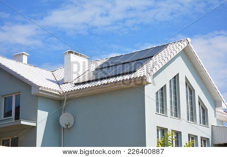 White Clay Tiled Roof And Solar Panels, Solar Water Heating For House Energy Efficiency. Modern Hous