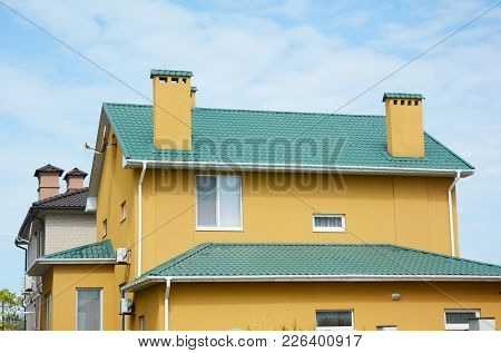 Repair Metal Roof With Renovate And Replace Metal Roof Tiles. House With Metal Roof, Brick Chimney,