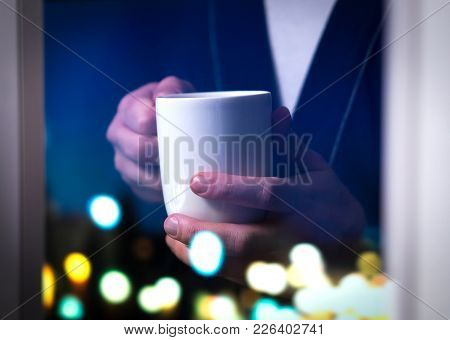 Man Holding Coffee Cup By The Window. Drinking Tea Or Hot Beverage. Insomnia Or Unable To Sleep. Sic