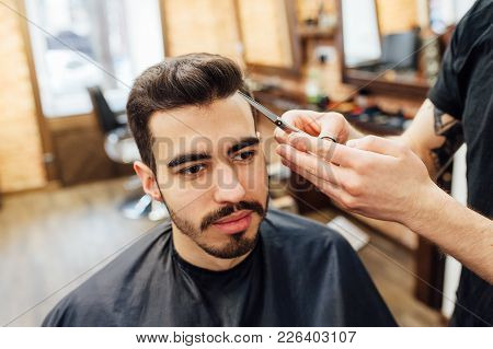 Male Model Shows A Haircut In A Barber Shop.
