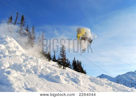 Flying Yellow Snowboarder