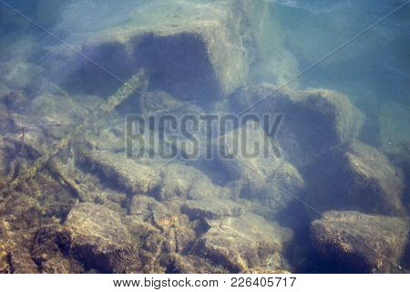 Cultivated Cube Rock Under Water In Abandoned Port