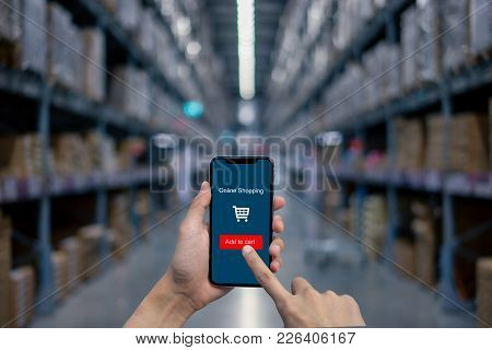 Man's Hand Shows Mobile Smartphone With Online Shopping Screen In Vertical Position For Shopping On