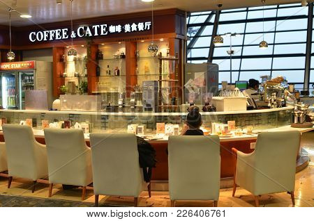 Shanghai, China- Jan 20, 2018: Customer Enjoy The Coffee In A Cafe Located Inside The Pudong Airport