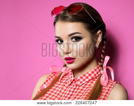 Closeup Portrait Of Young Beautiful Woman Red Wearing Heart Shaped Sunglasses. Smokey Eyes And Red L