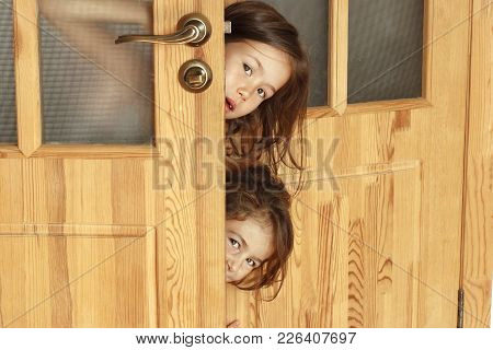 Children Curiously Look In The Morning In The Parents Room