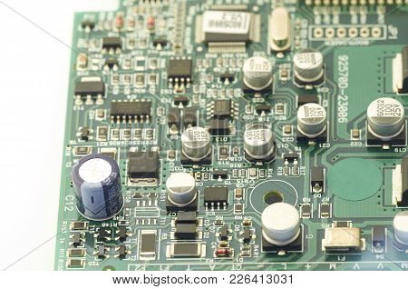 Electronic Circuit Board, Pcb (printed Circuit Board) With Processor, Microchips And Glowing Digital