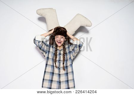 Russian Laughing Girl In A Hat With Ear-flaps Holds Valenki
