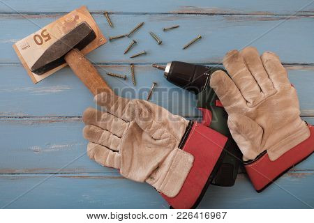 Handyman Tools On Blue Painted Boards With A 50 Euro Bill