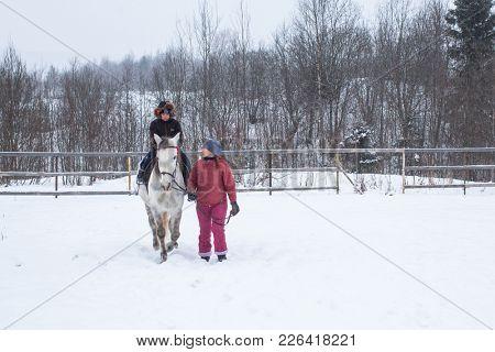PODPOROZHYE, RUSSIA - JAN 21, 2018: Training of children riding in the framework of revival program of the Cossacks in the Leningrad region. Cossacks in St.Petersburg began its revival in 1990.
