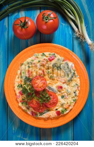 Omelet, fried chicken eggs with fresh vegetables