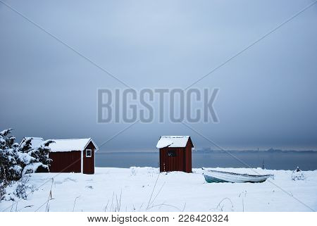 Winter View By Old Fishing Cabins At The Swedish Island Oland In The Baltic Sea