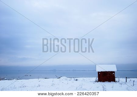 Coastal Snowscape With An Old Fishing Cabin By The Coast Of The Swedish Island Oland In The Baltic S