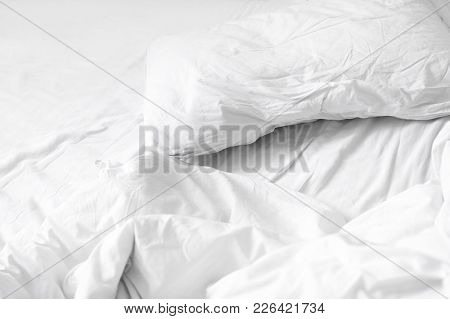 Top View. Close Up Unmade White Bedding Sheets And Pillow, Messy Bed After Night Sleep Concept. Text