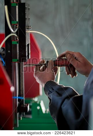 Hands Of Worker With Screwdriver - Repairs Of Machinery Equipment - Close Up