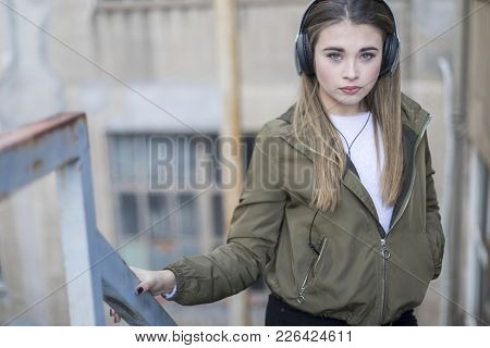 Teen Posing Listening To Music Wearing Headphones