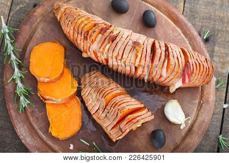 Sweet Organic Potato Yams On Wooden Board. Healthy Eating Concept.