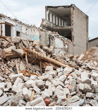 Pile Of Rubble And Demolished Building. Europe