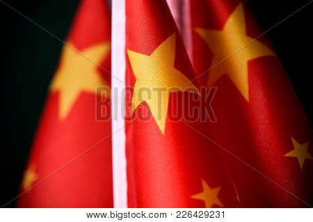 closeup of some flags of China put in line
