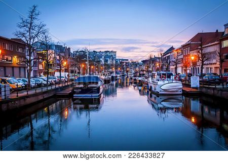Mechelen, Belgium. January 25, 2018. A Beautiful View Of The River Canal With Boats And Reflection I