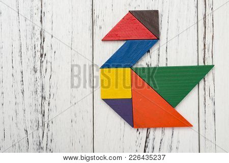 Wooden Tangram Shaped Like A Swan With Copy Space