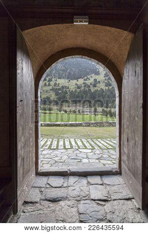 Vall De Nuria,spain-september 15,2011: Ancient Door Opened And View Landscape Mountain Catalan Pyren