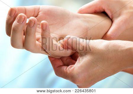 Macro Close Up Of Kinesiologist Manipulating Sensitive Area On Female Hand.