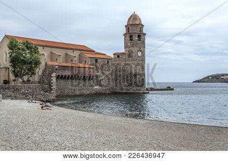 Collioure,france- June 17,2011: View Of Village Collioure In Cote Vermeille Coast. Tower And Church.