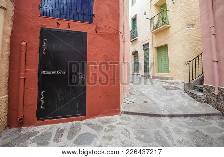Collioure,france-june 17,2011: Colored Walls Houses In Street Of Old Town Of Coullioure,cote Vermeil