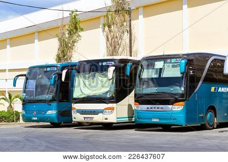 Rethymno, Greece - May 3, 2016: Passenger Intercity And Touristic Comfortable Buses Are Parked In Pa