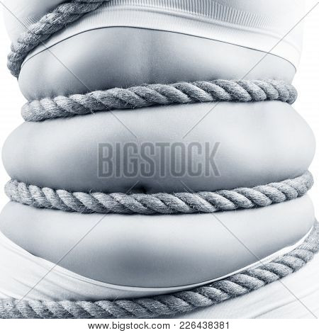 Fat Woman In White Underwear Twisted With A Rope. Obesity Concept. Over White Background.