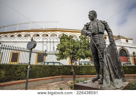 Seville,spain-november 16,2011: Bullring, Plaza De Toros La Maestranza And Statue Tribute To Curro R