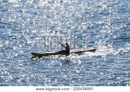 Person On A Kayak In The Sea