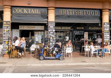 Benidorm, Spain - January 29, 2018: Tourists Sitting In A Sidewalk Cafe Outdoors In Benidorm, Spain