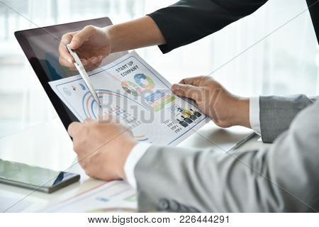 Businesswoman Hand Is Pointing To Business Chart Or Graph Document With A Pen.  Business People Disc