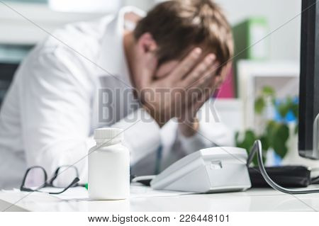 Stressed Doctor Cover Face Under Pressure. Sad Nurse, Tired Physician Or Upset Doc. Medic Crying In