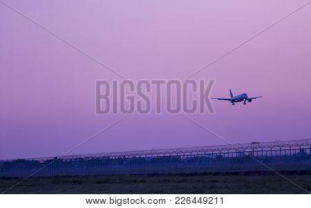Airplane Landing To Runway In Evening.flight Landing Save.