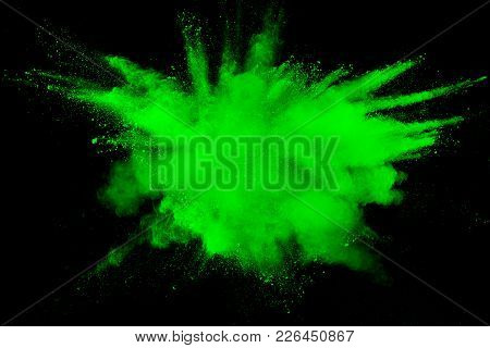 Green Color Powder Explosion Cloud Isolated On Black Background.green Dust Splashing On Dark Backgro