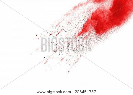 The Explosion Of Colored Powder. Beautiful Powder Fly Away. The Cloud Of Glowing Color Powder On Whi