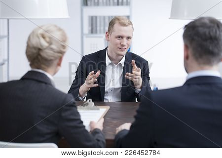 Young Businessman Convincing The Head Manager To Invest Money In His Start-up