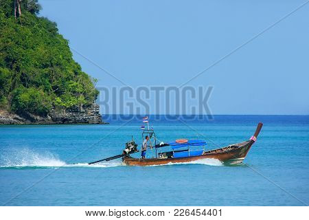 Krabi, Thailand - February 9: Unidentified Man Drives Longtail Boat From Phi Phi Don Island On Febru