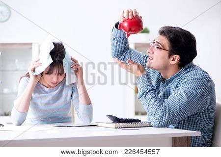 Young couple looking at family finance papers