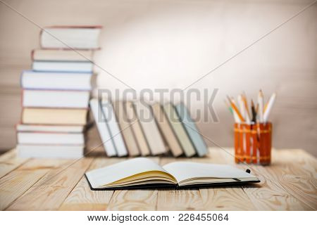 Textbooks And Books On A Wooden Table