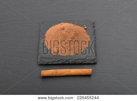 Colorful And Crisp Image Of Cocoa Powder And Cinnamon Stick On Shale