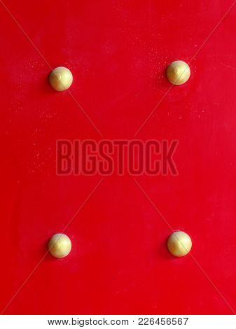 Close Up Of Wooden Red Gate Or Door With Gold Rivet Or Button Of Chinese Shrine Or Temple Used As Ba